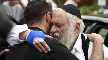 Rabbi Yisroel Goldstein (right) lost a finger during the shooting.