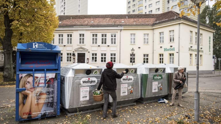 Recycling bins for clear and coloured glass in Potsdam, Germany. Germany sorts 65 per cent of its waste into colour-coded bins: blue for paper, yellow for plastic, brown for composting and black for general waste.