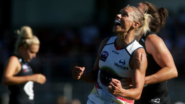 Erin Phillips of the Crows celebrates on the final siren.