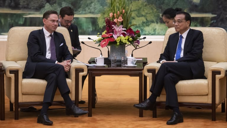 European Commission Vice President Jyrki Katainen (left) attends a meeting with China's Premier Li Keqiang in Beijing.