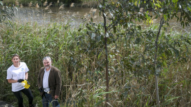 Nicole Kowalczyk and Andrew Kelly in the reed beds along the banks of the Yarra.