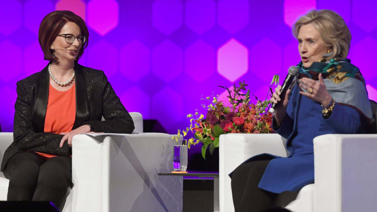 Former US secretary of state Hillary Clinton speaks with former Australian prime minister Julia Gillard.