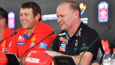Dew fronts the media with Port coach Ken Hinkley in Shanghai last year.
