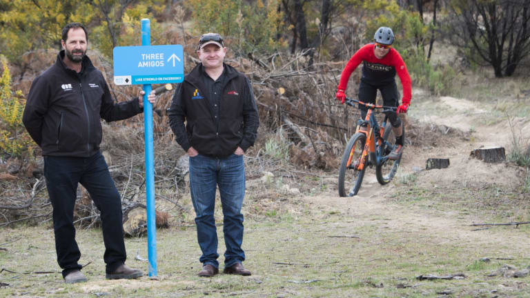 Stromlo Forest Park manager Jeff van Aalst, Canberra Off-Road Cyclists vice president Darren Stewart with mountain biker and volunteer trail builder Ryan Walsch at Three Amigos, a new trail.