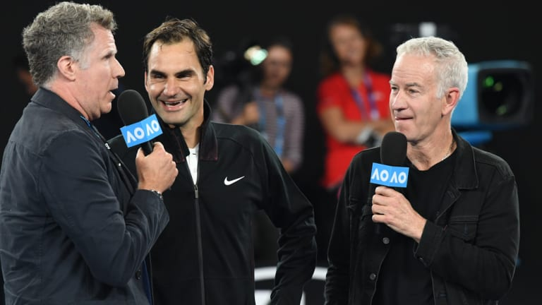 Actor Will Ferrell and John McEnroe conducting a post match interview with Roger Federer at 2018's Australian Open.