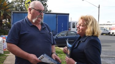 Liberal candidate Julia Ham hands out how to vote cards on Thursday