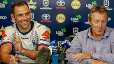 A relieved Cameron Smith and Storm coach Craig Bellamy enjoy the post-game conference.,