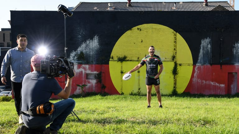 True colours: Greg Inglis cracks a laugh during the photo shoot.