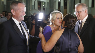 Opposition Leader Bill Shorten and Chloe Shorten with Prime Minister Scott Morrison and Jenny Morrison as they arrive for the Mid Winter Ball.