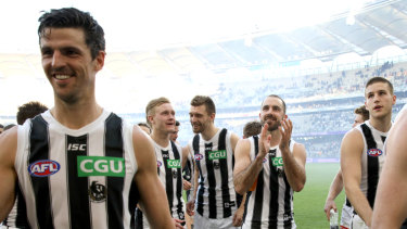 Happy days: The Magpies leave the field in Perth.