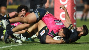 Jason Taumalolo barges over the top of James Tamou to score.