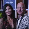 News anchor Lauren Sanchez poses with Amazon CEO Jeff Bezos during an event in India.