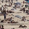 Man charged after allegedly inappropriately touching two girls at Sydney beach