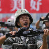 China signals it's 'moving troops to the border' with Hong Kong