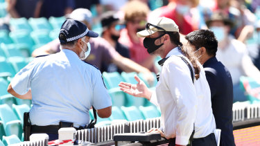 Police and SCG security discuss allegations of crowd abuse.
