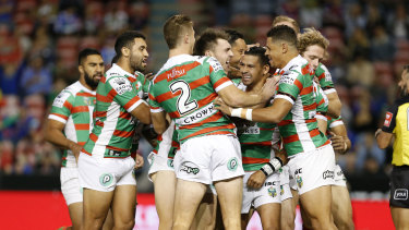 That's the way: Cody Walker is embraced by teammates after scoring against the Knights.