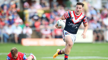 Lachlan Lam makes a break for the Roosters.