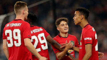 Mason Greenwood (right) is congratulated by teammates after scoring against Leeds.