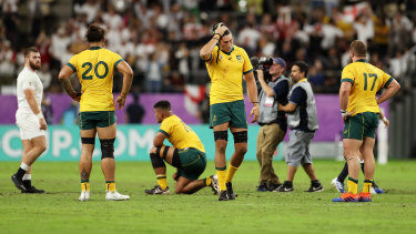 All over: The Wallabies are shattered after the heavy loss to England.