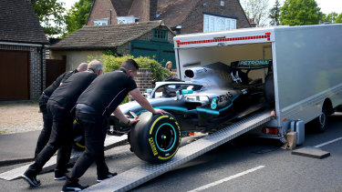 Members of the Mercedes team delivering the Formula One replica.