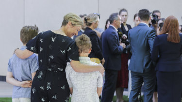 Lucy Quarterman, and her children Luca and Ben, watched Richard Di Natale resign as Greens leader on Monday.