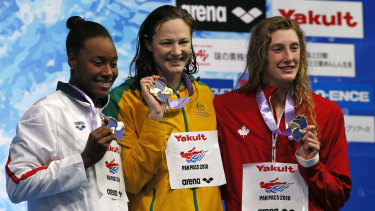 Crowning moment: Cate Campbell on the podium with second-placed Simone Manuel, left of the US, and third-placed Ruck Taylor of Canada.