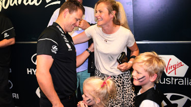 All smiles: A happy Easter Sunday for Carlton coach Brendon Bolton and his family.