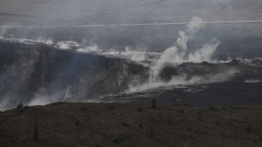 Steam and gas rise along the edge of Kilauea's summit crater.