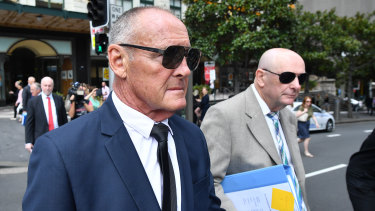 Chris Dawson (left) and brother Peter Dawson leave the Downing Centre court on Thursday.