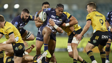 Brumbies winger Solomone Kata tries to find his way through traffic against the Hurricanes in Canberra.