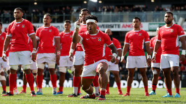 Issuing the challenge: Siale Piutau of Tonga leads the Sipi Tau ahead of the Test match against the All Blacks in Hamilton.