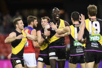 The Tigers' Mabior Chol (centre) will join Gold Coast as a free agent.