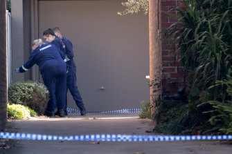 Forensic officers at the Park Street apartment block.