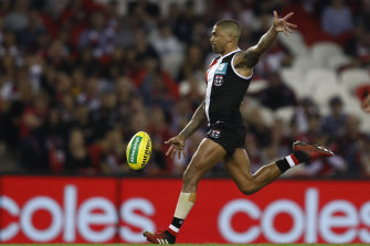 Bradley Hill gets a kick away for St Kilda in their win over Hawthorn.