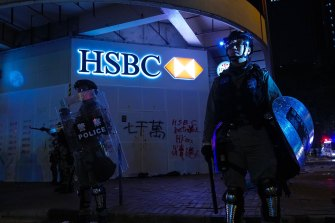 Police guard an HSBC bank branch on New Year's Day in Hong Kong.
