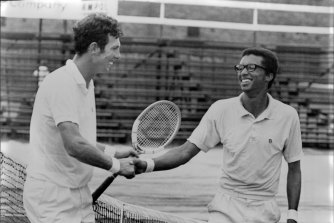 Arthur Ashe, right, is congratulated by Dick Crealy after winning the 1970 Australian Open men's singles.