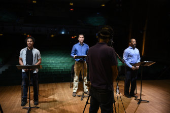 Daniel Yearwood, Josh Davis and T. Oliver Reid filming the Fatigue section of the new musical Breathe in an empty New York theatre.