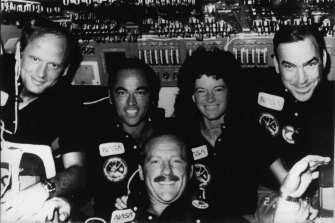 The STS-7 crew poses for a portrait in Challenger's flight deck area  during the Earth orbital mission. From left are mission specialist Norman Thagard, commander Robert Crippen, pilot Frederick Hauck, and mission specialists Sally Ride and John Fabian.