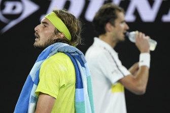 Stefanos Tsitsipas walks past Daniil Medvedev during their semi-final clash.