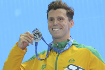 Thomas Fraser-Holmes shows off his silver medal at the FINA World Swimming Championships in China in 2018.