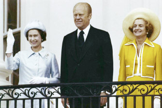 The Queen waves from the balcony of the White House, as she stands with president Gerald Ford and first lady Betty Ford in 1976.