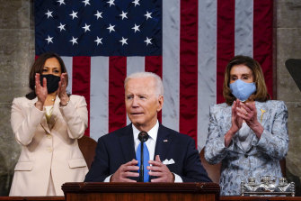 Vice-President Kamala Harris and House Speaker Nancy Pelosi stand and applaud as President Joe Biden addresses a joint session of Congress at the US Capitol in Washington.