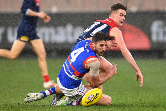 The Demons' Bayley Fritsch and Bulldog Marcus Bontempelli battle for possession.