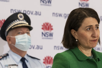 NSW Premier Gladys Berejiklian flanked by NSW Police Commissioner Mick Fuller on Saturday.