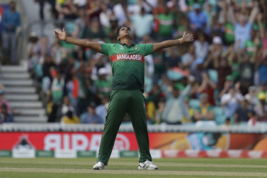 Bangladesh's Mohammad Saifuddin claims the scalp of South Africa's Rassie van der Dussen.