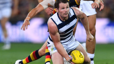 Top Cat: Patrick Dangerfield looks for a handball under pressure.