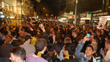 Thousands of jubilant Richmond fans filled Swan Street on Saturday night to celebrate the Tigers' second grand final win in three years.