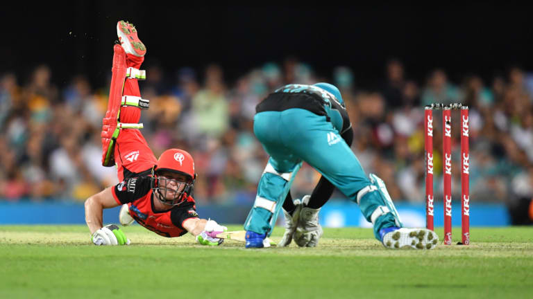 Desperate lunge: Renegade Sam Harper dives back into his crease to avoid being stumped.
