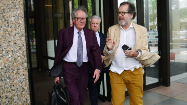 Geoffrey Rush, with theatre director Neil Armfield outside court on Wednesday.