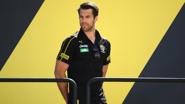 On the outer: Injured Richmond star Alex Rance was among the crowd at the Tigers' premiership celebrations yesterday.
